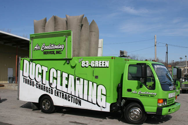 Air duct cleaning service green truck.
